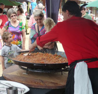 Spanish gluten free and healthy Paella cooking at a family friendly festival in Australia.