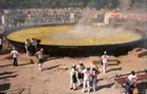 The world's largest Spanish paella dish being cooked.